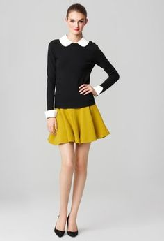 Cute look for fall. Like the colourful skirt and the black and white top. Always match with flats...