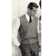 Mens Sweater Vest Knitting Pattern.   This is a pullover vest that features a smart v-neck, and cable bands that run across the shoulders and down, in columns, on both sides. There is a nice variations with the cables in that the run around the bottom band, versus the typical ribbing.
