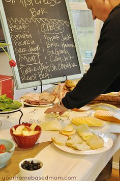 Make Your Own sandwich bar. sign for the meats cheeses and breads.