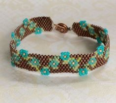 Handmade Peyote Stitched Bracelet in a Floral by mariposabeadworks