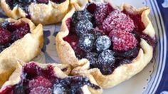 """The perfect solution to your next """"pie emergency"""" . . . tiny berry tartlets come together in a snap with pre-made pastry and a little ingenuity!"""