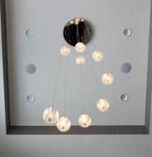 Modern glass ball light fixture   Homes by DePhillips Construction