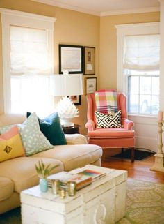 coral chair with pops of color in a neutral living room. Soft & lovely!