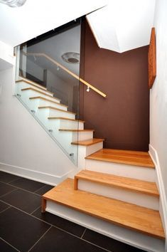 Check out our photo gallery of Modern Stair Railing Ideas.  #ModernStairRailing #StairRailing #Glass