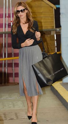 Abbey Clancy looks chic in grey pleated midi skirt with front slits and black heels