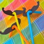 These are pretty self-explanatory…   ….but they made Emily and me giggle! Straws + black construction paper moustaches = Fun!! And just in time for Cinco de Mayo.