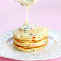 Cake Batter Pancakes-Great idea for birthday morning or after a sleep over birthday party! Ingredients 1 1/4 cups all purpose flour 1 cup Betty Crocker Supermoist yellow cake mix 1 Tablespoon sugar 3/4 teaspoon baking powder pinch of salt 2 large eggs 1 teaspoon vanilla extract 1-2 cups milk assorted sprinkles For the Glaze: 1 cup pow