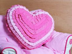 A heart-shaped pink cushion made in cotton. Polka dots and check pattern are printed on various layers of fabric with different shades of pink. Cushion Tutorial, Pink Cushions, Different Shades Of Pink, Cushion Covers, Hair Band, Heart Shapes, Polka Dots, My Favorite Things, Pretty