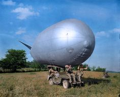 US Army soldiers use a jeep to move a Very Low Altitude (VLA) antiaircraft balloon (barrage balloon) during a training exercise in southern England before D-Day, circa May Original photo taken by the US Signal Corps Colorized History, Colorized Photos, Ww2 Photos, History Photos, Us Army Soldier, D Day Landings, Samana, Story Of The World, World War Two