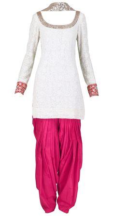 striking punjabi suit with color blocking: white kameez with fuchsia salwar