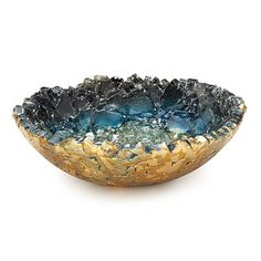 This richly textured vessel is a treasure of kiln-formed glass adorned with lustrous copper.