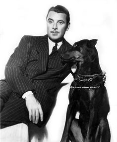 The dog is adorable, the man is handsome. Puppies And Kitties, Dogs, George Brent, Ann Sheridan, Classic Movie Stars, Bette Davis, Old Hollywood, Classic Hollywood, Silent Film