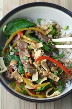 Skip the takeout and make your own Asian rice bowl at home! Much tastier and a whole lot healthier! A delicious mix of sirloin steak, colorful peppers, spinach, and tender rice.
