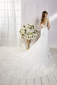 Ronald Joyce offers bridal dresses & wedding gowns with perfectly structured bodices. We craft dresses using couture techniques & quality fabrics. Designer Wedding Dresses, Bridal Dresses, Wedding Gowns, Ronald Joyce Wedding Dresses, Short Sleeve Dresses, Dresses With Sleeves, Wedding Dress Accessories, Ball Gowns, Dress Ideas