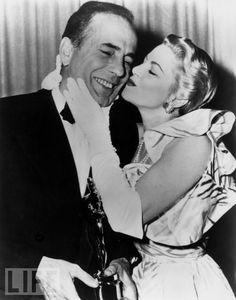 At the 1952 Oscars, Bogie gets a congratulatory kiss from Claire Trevor for winning Best Actor for The African Queen. Trevor had won Best Supporting Actress three years prior in Key Largo opposite Bogart.