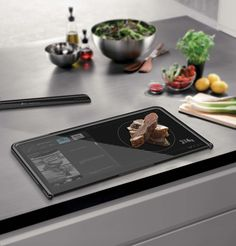 Smart board that serves as a cutting board, scale and displays recipes!!! WANT!!