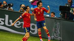 David Silva [21] of Spain celebrates with Álvaro Arbeloa [17] after scoring the opening goal during the UEFA EURO 2012 final against Italy.