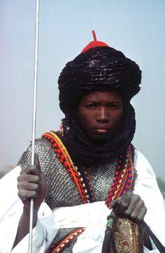 Africa | A young warrior during the Kaduna Durbar. 1977, Nigeria | ©Bruno Barbey.