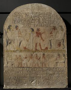 Djéhouty et son épouse Henout reçoivent une libation de leurs enfants  vers 1500 - 1400 avant J.-C.  calcaire H. : 78 cm. ; L. : 59 cm.  Département des Antiquités égyptiennes C 63