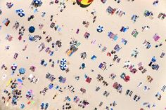 Gray Malin's series 'A la Plage'. From above, people and objects become patterns, creating repetition, shape and form. Malin's photographs are a visual celebration of color, light, shape—and summer bliss.