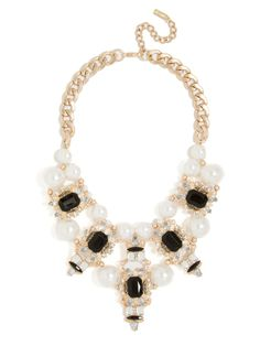 An unapologetic mix of classic and modern: Oversized pearls contrast octagon-cut crystals in ornate crystallized settings in a fabulously over-the-top art-deco style.