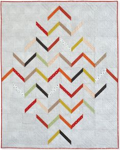 The chevron quilt gets a makeover with this sleek design from Bev Getschel. Quick and simple blocks in modern batiks add to this 60