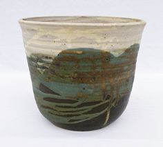 Toshiko Takaezu (1922-2011 New Jersey) Large Studio Pottery Drip Glaze Bowl 8.5''x10''. Impressive bowl by this well known Japanese American potter. Covered in white, green, and black slip glazes. Incised with her ''TT'' mark on bottom.