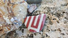 White and red Tile from the Greek sea.