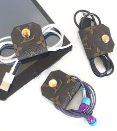 Louis Vuitton Cord Wrap made with authentic canvas ONE ... Earbud Wrap, Cord Tie, Cord Keeper Upcycled by LoveYouMoreStore on Etsy https://www.etsy.com/listing/503710717/louis-vuitton-cord-wrap-made-with