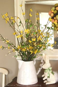 Spring flowers, forsythia and pussywillow at www.chiconashoestringdecorating.blogspot.com