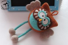 Brown owl with turquoise wings . Made on a Styrofoam form