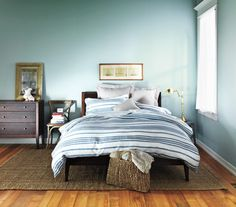 """The Seaside Sleep Nook: """"Soft blue walls and neutral floors, reminiscent of sky and water against sand, are calming."""" [I like the sea-grass rug for the living room maybe. Seaside Bedroom, Simple Bedroom Decor, Bedroom Ideas, Bedroom Makeovers, Bedroom Photos, Bedroom Colors, Organizer, Home Organization, Decor Styles"""