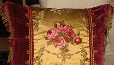 antique pillow hand made with a deep red silk velvet and an embroided bunch of roses _ gilt metallic fringe and semi precious beads
