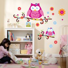 """Owl Blossom Giant Wall Decals Includes: (11) reusable vinyl wall decals, light switch decoration, (1) yellow 3"""" squeegee and full use and care instructions. For use on smooth, flat surfaces. Largest d"""