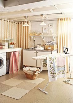 basement laundry room.. like the idea of the hanging full length curtains as a backdrop to cover the cinder blocks