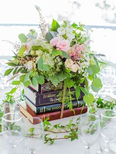 Creative Ways to Use Books as Wedding Décor Embrace your inner bookworm with these 14 creative ways to use books as wedding decor.Embrace your inner bookworm with these 14 creative ways to use books as wedding decor. Book Wedding Centerpieces, Unique Centerpieces, Wedding Table Centerpieces, Wedding Flower Arrangements, Wedding Decorations, Centerpiece Flowers, Centerpiece Ideas, Floral Arrangements, Book Decorations