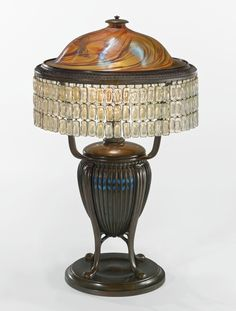 "Tiffany Studios | A RARE CHAINMAIL TABLE LAMP with a ""Greek"" base inset with favrile mosaic glass shade engraved L.C.T. base impressed TIFFANY STUDIOS/NEW YORK/S1141 favrile glass, favrile mosaic glass and patinated bronze 26 1/4  in. (66.7 cm) high 