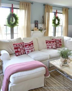 Wall color and wreaths in window