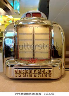 Table top juke boxes.  I remember this style of juke box at the DonDo Diner in Larned, Kansas in the 50's & early 60's