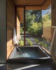 Serene bath | via dwell magazine | bathroom  bathtub  neutral palette  natural finishes  large windows