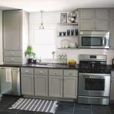 gray shaker cabinets with subway tile by allisonn