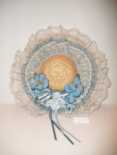 vintage straw hat decorated with blue lace ribbon & flowers