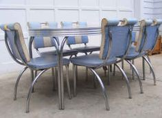 I think THIS vintage set is kinda cute! Chrome/formica 50's dinette set