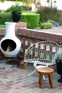 Awesome Painted White Chiminea On Front Patio   Brick Lattice Wall