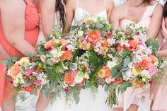 Coral colored wedding bouquets | Natalie Heim Photography on @tidewatertulle via @aislesociety