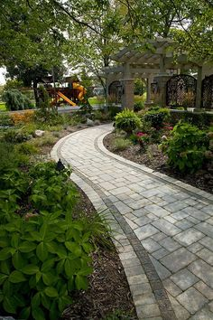 Landscaping St. Louis, curved paver walkway.