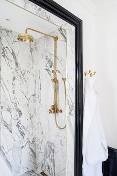 Traditional brass shower, marble tile, gloss black door architrave, traditional Lefroy Brooks shower-head and hand-set with matching brass robe hooks. Lawrence Street, Architects London, Polished Plaster, High Gloss Paint, Marble Showers, Residential Architect, Architrave, Roof Light, Marble Effect