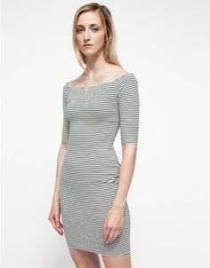 A modern off-the-shoulder striped dress from Shakuhachi with structured styling. Features a sculptural v-wire neckline, grosgrain ribbon-trimmed back zipper closure and a fitted silhouette throughout.   •Off-the-shoulder dress •Sculptural v-wire ne