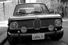 BMW 2002 with wheels curbed