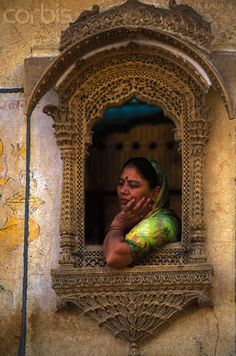 Woman Looking Out Traditionally Carved Windowsill in Jaisalmer State Of Decay, Miss India, Jaisalmer, India Colors, Rich Image, Window Sill, Balconies, Photo Library, Wood Carving